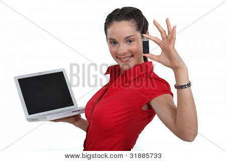 Woman holding laptop and USB drive
