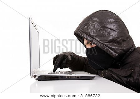 Computer Hacker stealing information from a laptop, isolated over white background