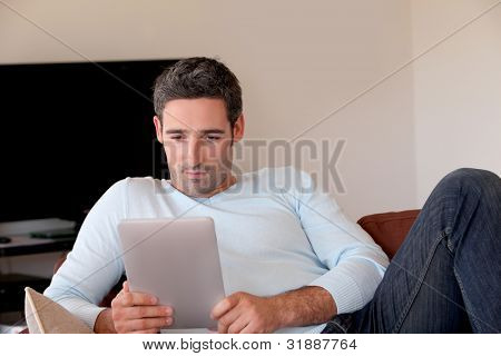 Man websurfing on internet with digital tablet