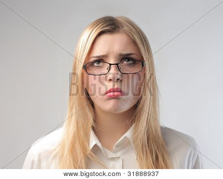Young businesswoman with disappointed expression