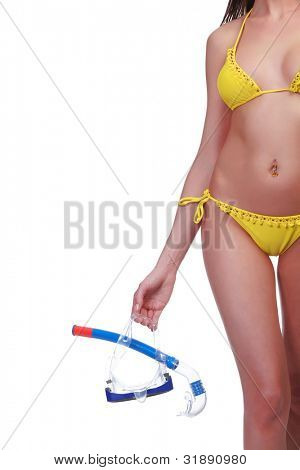 Woman with goggles and snorkel posing against white background