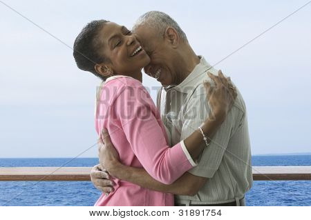 Couple hugging on cruise ship