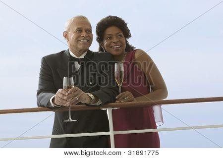 Formal couple drinking wine together