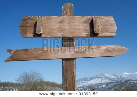 index with arrow in mountains