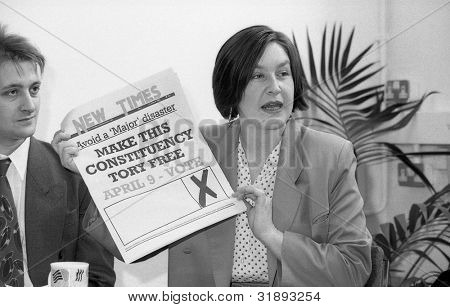 LONDON - MARCH 19: Nina Temple, Secretary of the Democratic Left party, speaks at their manifesto launch press conference on March 19, 1992 in London. Joe Marshall, Assistant Secretary, on the left.