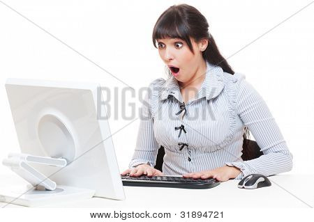 studio shot of shocked businesswoman with computer. isolated on white