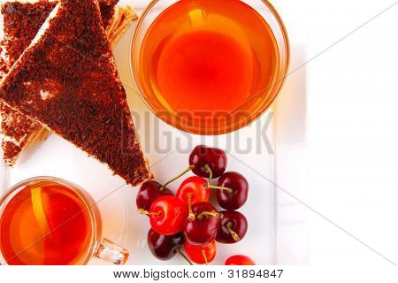 chocolate cakes with tea and cherry