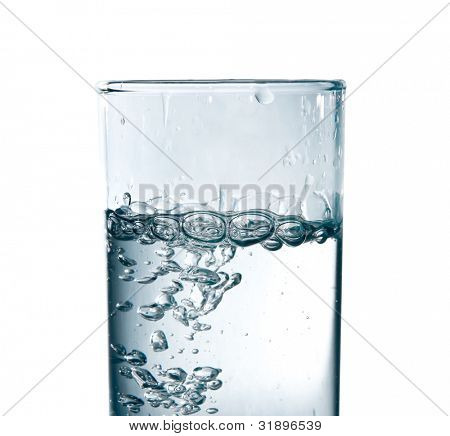 studio shot of pouring water in glass