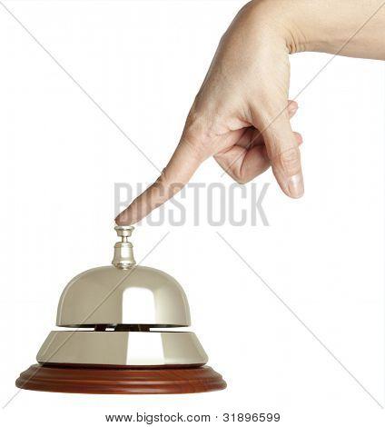 Hand einer Frau, die mit eine Hotel-Glocke isoliert