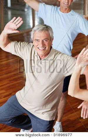 Dancing elderly man in fitness center class