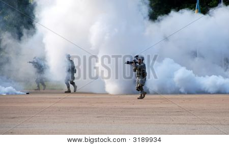 Soldiers Emerging From Smoke