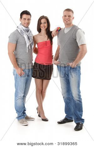 Summer portrait of trendy college student friends standing together, smiling, looking at camera. Cutout, full length.