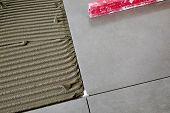 Ceramic Tiles And Tools For Tiler. Floor Tiles Installation. Home Improvement, Renovation - Ceramic  poster