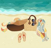 Summer at the Beach - stylish accessories on golden sand, at the beach: summer hat, straw bag, flip