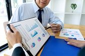 Business Businessman In Meeting Analyses Chart Graphy Marketing Plan In Business Financial  Audit Pr poster