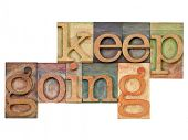 keep going - motivation  concept - isolated text in vintage letterpress wood type
