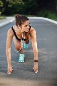 Vertical Shot Athletic Sporty Woman Standing Low Start On Concrete Road In Empty Park, Look Aside, L poster