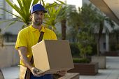 Brazilian Mailman Delivering A Package. poster