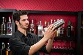 image of posh  - Handsome barman professional at posh bar making cocktail drinks - JPG
