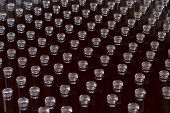 Closeup Perspective View Of Many Wine Bottles With Glass Cap Enclosures Arranged In Rows In Winery S poster