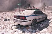NEW YORK - SEPTEMBER 11: Ash covers a NYPD vehicle as it lies near the area known as Ground Zero aft