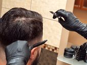 Stylist Cutting Clients Hair With Scissors And Comb, Close Up View. Hairdressers Hands In Black Rubb poster