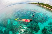 Happy Family - Mother, Kid In Snorkeling Mask Dive Underwater, Explore Tropical Fishes In Coral Reef poster
