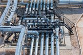 Industrial Zone,the Equipment Of Oil Refining,close-up Of Industrial Pipelines Of An Oil-refinery Pl poster