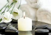 picture of white flower  - Spa setting with Beautiful white flowers pebbles and candle - JPG