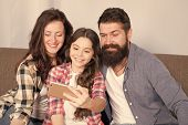 Little Girl Use Smartphone With Mother And Father. Bearded Man And Woman With Little Girl. Mother An poster