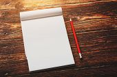 Notebook With A Red Pencil On A Brown Background With Warm Sunlight, For Writing. Free Empty Space F poster