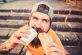 Man Bearded Eat Tasty Sausage. Urban Lifestyle Nutrition. Junk Food. Carefree Hipster Eat Junk Food  poster