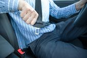 Close Up Of Man Driver Sitting On Car Seat And Fastening/wearing Seat Belt. Safety, Transportation,  poster