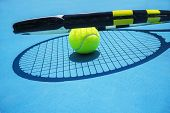 Summer Sport Concept With Tennis Ball And Racket On Blue Hard Tennis Court. Top View, Copy Space. Bl poster