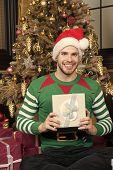 Man Celebrate New Year Or Christmas Holiday. Man Santa Hat Celebrate Christmas Baroque Interior Deco poster