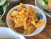Crispy Wonton Chips Serve With Thai Style Noodle Soup. poster
