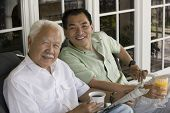 picture of early 60s  - Father and Son Having Breakfast Together - JPG