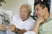 pic of early 60s  - Father and Son Reading Newspaper Together - JPG