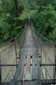 foto of shaky  - Shaky wire bridge over a mountain stream - JPG