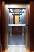 stock photo of elevator  - Open door of modern elevator in new building - JPG