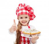 pic of cute little girl  - My first muffins are ready  - JPG