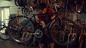 Theme Small Business Bike Repair. Young Caucasian Brunette Man Wearing Safety Goggles, Gloves And Ap poster