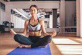 Yogi Woman Practicing Yoga Lesson, Breathing, Meditating, Doing Ardha Padmasana Exercise, Half Lotus poster