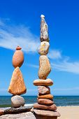 Two Rock Zen Pyramids Of Colorful Pebbles On A Beach On The Background Of The Sea. Concept Of Balanc poster