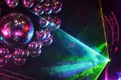 picture of laser beam  - Beautiful shiny balls and colorful rays on ceiling in night club - JPG