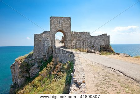 Oldl gate guarding the entrance in the medieval fortress on cape Kaliakra, Bulgaria.