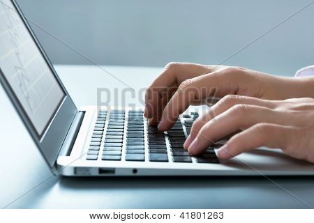 Closeup of businessman typing on laptop computer