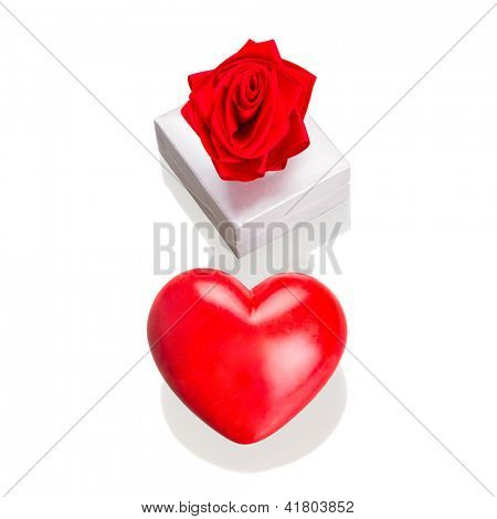 Gift box with red heart as love symbol isolated over white