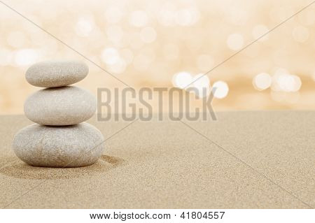 Balance Zen Stones In Sand On White