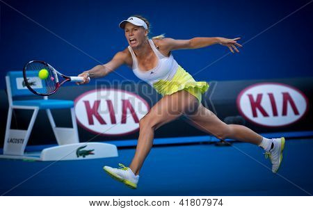 MELBOURNE - JANUARY 19: Caroline Wozniacki of Denmark in her third round win over Lesia Tsurenko of Ukraine at the 2013 Australian Open on January 19, 2013 in Melbourne, Australia.